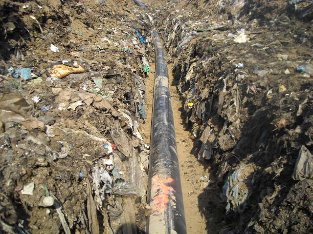 A HDPE pipe in a landfill trench