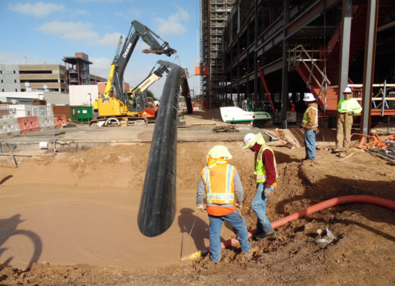 ISCO chilled and hot water HDPE pipes being installed in Tucson
