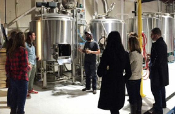 A group of visitors at a brewery using PPR pipe