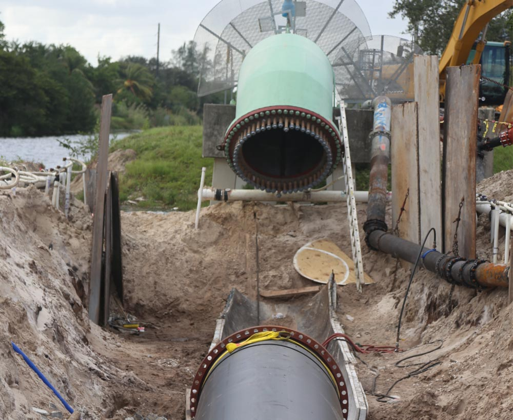 Installation of large HDPE pipe being at a wastewater treatment facility